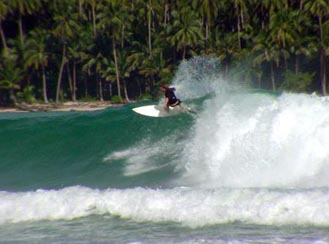 Jason surfing at Nias